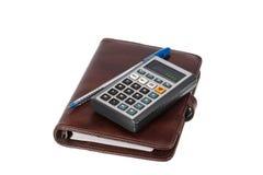 Stylo bille, calculatrice et carnet simples Images stock