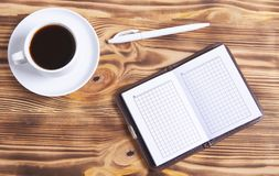 Stylo et carnet de café photo stock