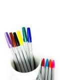 Stylo magique coloré sur le fond blanc Photos libres de droits