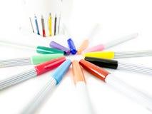 Stylo magique coloré sur le fond blanc Photographie stock libre de droits