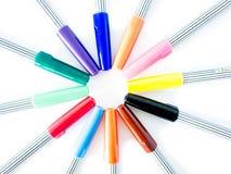 Stylo magique coloré sur le fond blanc Photo libre de droits