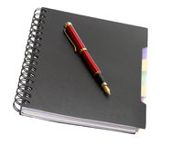 Stylo-plume sur le cahier Photos libres de droits
