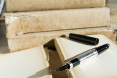 Stylographic pen and ancient manuscript Stock Photos