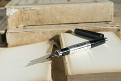 Stylographic pen and ancient manuscript Royalty Free Stock Photography