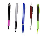 Stylos et crayon ouvert d'isolement sur le blanc Photo stock