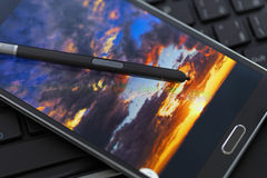 Stylus pen with mobile phone Royalty Free Stock Image