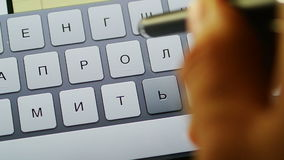 Stylus typing Russian on tablet computer. Man with stylus typing fast text messages on smart tablet or phone in Russian language stock footage
