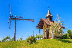 Styrian Tuscany Vineyard with small chapel and windmill, Styria, Stock Photo