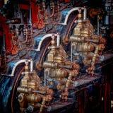 Styrning och justeringsspakar av en tappningångamotor royaltyfri foto