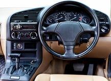 Styrningen wheel in konsolbilen Royaltyfri Fotografi