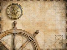 Styrninghjul och kompass med nautisk tappning stock illustrationer