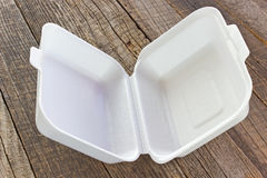 Styrofoam box for food. On wooden table stock images