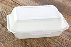 Styrofoam box for food. On wooden table stock photo