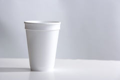 Styrofoam Cup on desk Stock Image