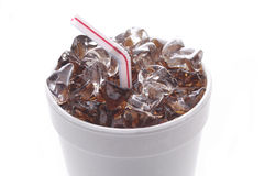 Styrofoam Cup with Soda. Ice and Straw isolated on white with reflection vertical format royalty free stock photography