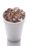 Styrofoam Cup with Soda. Styrofoam Cup with Ice and Cola isolated on white with reflection vertical format stock image