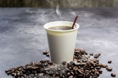 Styrofoam Cup With Hot Coffee And Coffee Beans Stock Photography