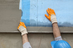 Styrofoam facade insulation, installing mesh Royalty Free Stock Images