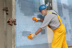 Styrofoam facade insulation, installing mesh Stock Photos