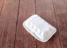 Styrofoam food container on wooden table Royalty Free Stock Photos