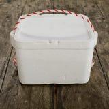 Styrofoam storage box on wood table Royalty Free Stock Images