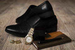 Stysh male accessories. In wooden background Stock Photos