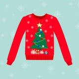 Suéter de la Navidad en fondo azul con los copos de nieve Imagenes de archivo