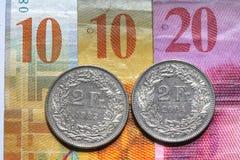Suíço Frank Bills e moedas imagens de stock