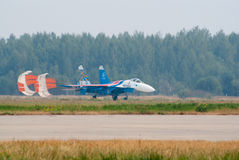 Su-27 with brake parachute Royalty Free Stock Image