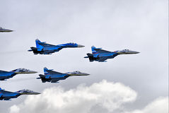 SU-27 in clouds Stock Photos