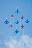 SU-27 and MIG-29 fighters performing aerobatics. SU-27 and MIG-29 fighters performing group aerobatic elements at MAKS aviation salon August 26, 2007 in stock photography
