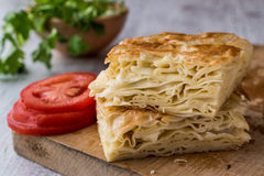 Su Boregi / Turkish Patty with greens and tomatoes. Royalty Free Stock Photography