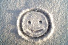 Su cara feliz en la nieve foto de archivo libre de regalías