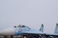 Su-35 fighter at the air show. Aircraft on the airfield to show the audience. The nose of the plane and the cockpit. Royalty Free Stock Photos