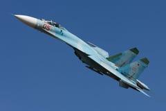The Su-27 fighter performs aerobatics. Demonstration flights, Krasnodar, Russia, August 19, 2012 Stock Photos