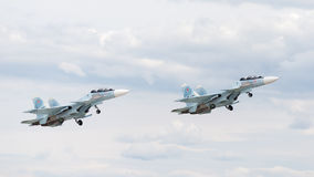 Su-30 flying at an airshow Royalty Free Stock Photo