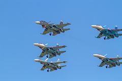 Su-30 and  four Su-27 in the blue sky Stock Photography