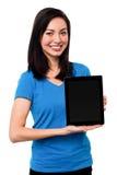 Su mi nueva PC digital de la tableta imagen de archivo libre de regalías