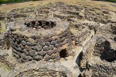 Su Nuraxi in Sardinia, Italy. Nuraghe Su Nuraxi in Sardinia (Italy), is a typical Bronze Age building. The oldest part of the Nuraghe consists of a central tower stock photography
