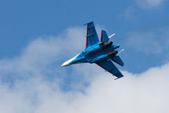 Su-27 performing aerobatics at an airshow. Samara, Russia - August 22. 2015: Demonstration performances of flight group Falcons of Russia on Su-27. Airshow Stock Images