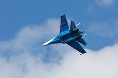 Su-27 performing aerobatics at an airshow Stock Images
