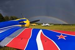 SU-26 sport airplane on the airfield. Rainbow over the sky. Kozelsk russia Stock Photos