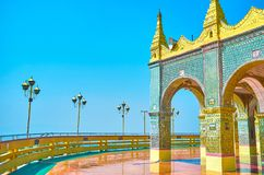 The decorated Su Taung Pyae Temple in Mandalay, Myanmar. The Su Taung Pyae Temple located at the top of Mandalay hill and boasts huge terrace with great view on stock photography