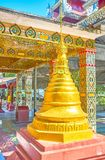 The golden pagoda at the entrance of Su Taung Pyae Temple, Mandalay, Myanamar. The Su Taung Pyae Temple is the most visited tourist attraction, and the most stock images