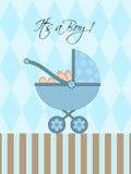 Su un cochecito de niño del bebé azul del muchacho Imagen de archivo libre de regalías