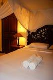 Su un letto di alloggio presso famiglie di Bali Immagini Stock Libere da Diritti
