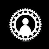 Su un uomo nero del fondo nel cerchio dell'ingranaggio Immagini Stock Libere da Diritti