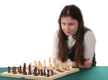 Su vuelta. Muchacha que invita para jugar a ajedrez Imagen de archivo libre de regalías