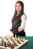 Su vuelta. Muchacha que invita para jugar a ajedrez Foto de archivo libre de regalías