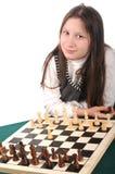 Su vuelta. Muchacha que invita para jugar a ajedrez Fotografía de archivo libre de regalías